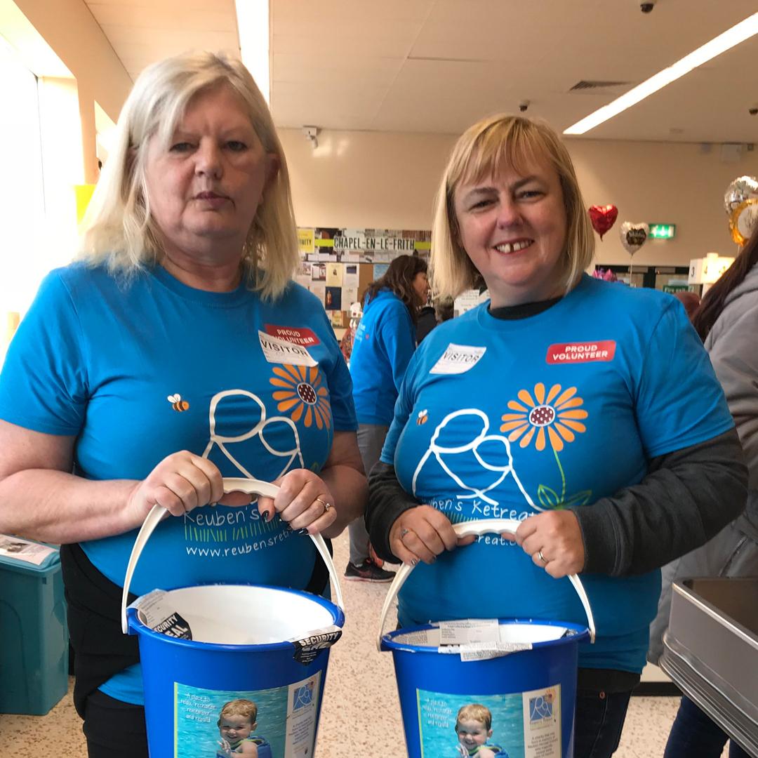 REUBeneers with donation buckets for Reuben's Retreat